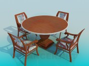Round table on a thick stalk with chairs in the complete set