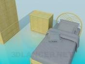 Conjunto de muebles de mimbre en el dormitorio