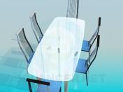 Стеклянный обеденный стол со стульями на металлической основой
