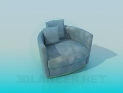 तकिए के साथ एक कुर्सी