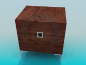 A small wooden bedside table
