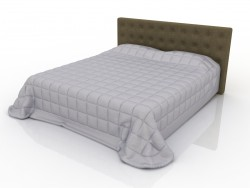 Double bed with upholstered headboard and quilt