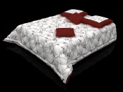 Quilted bedcover and pillows on the bed