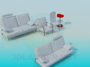 A set of sofas with chairs