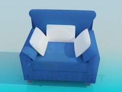Üç yastık ile geniş koltuk