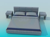 Bed with tables