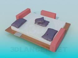 Bed with wooden bridges