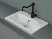 Marble sink with faucet and pipes