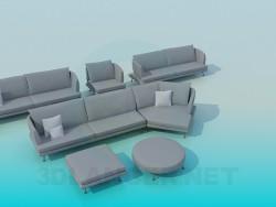 Un conjunto de muebles tapizados