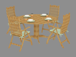A set of garden furniture with green pillows