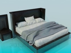 Bed with high headboard